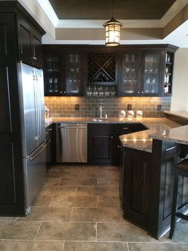 Dark Cabinets With Darker Neutral Tile Subway Backsplash And Granite Countertops