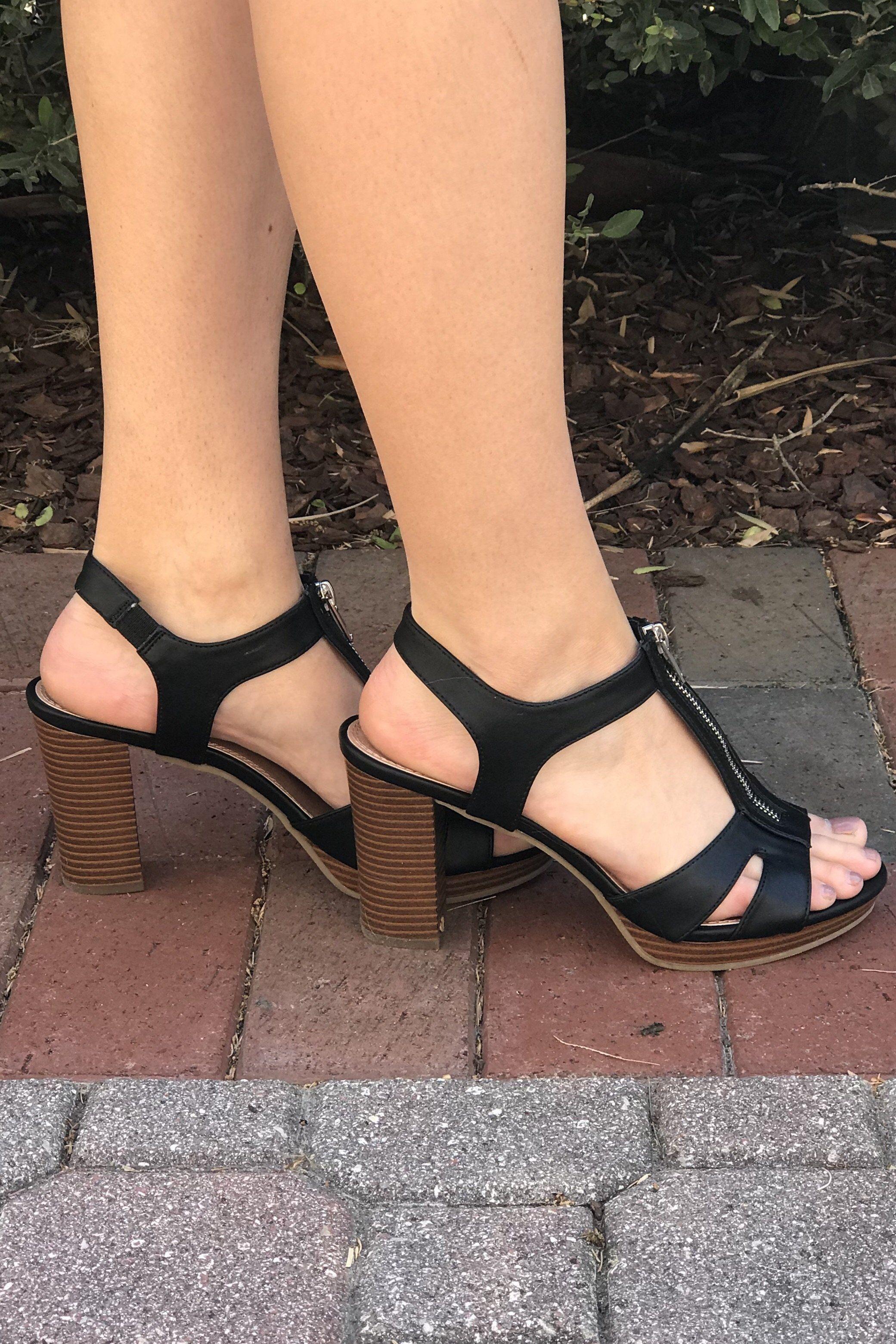 56de17cc894 Black open toe, open heel, block heel shoe with zipper on top of ...
