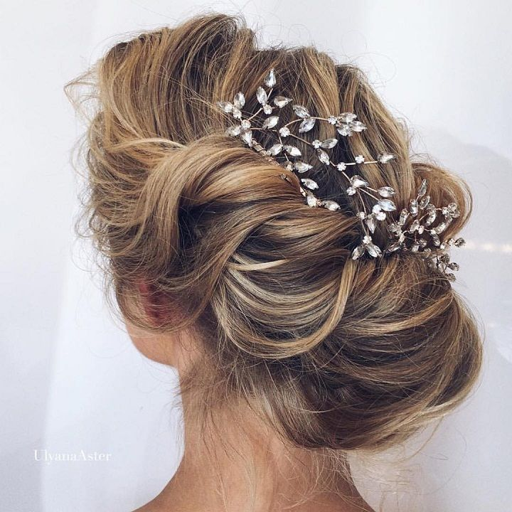 bridal updo hairstyle with pretty hair accessories #weddinghair #bridalhair #hairstyle #updos #hairstyles #wedding #bridalupdos