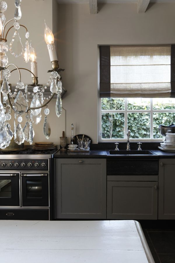 Glamour with a crystal chandelier. Love the plan with sink by the range. Love simple hood & roman shade. Love beams & palette. Center sink...