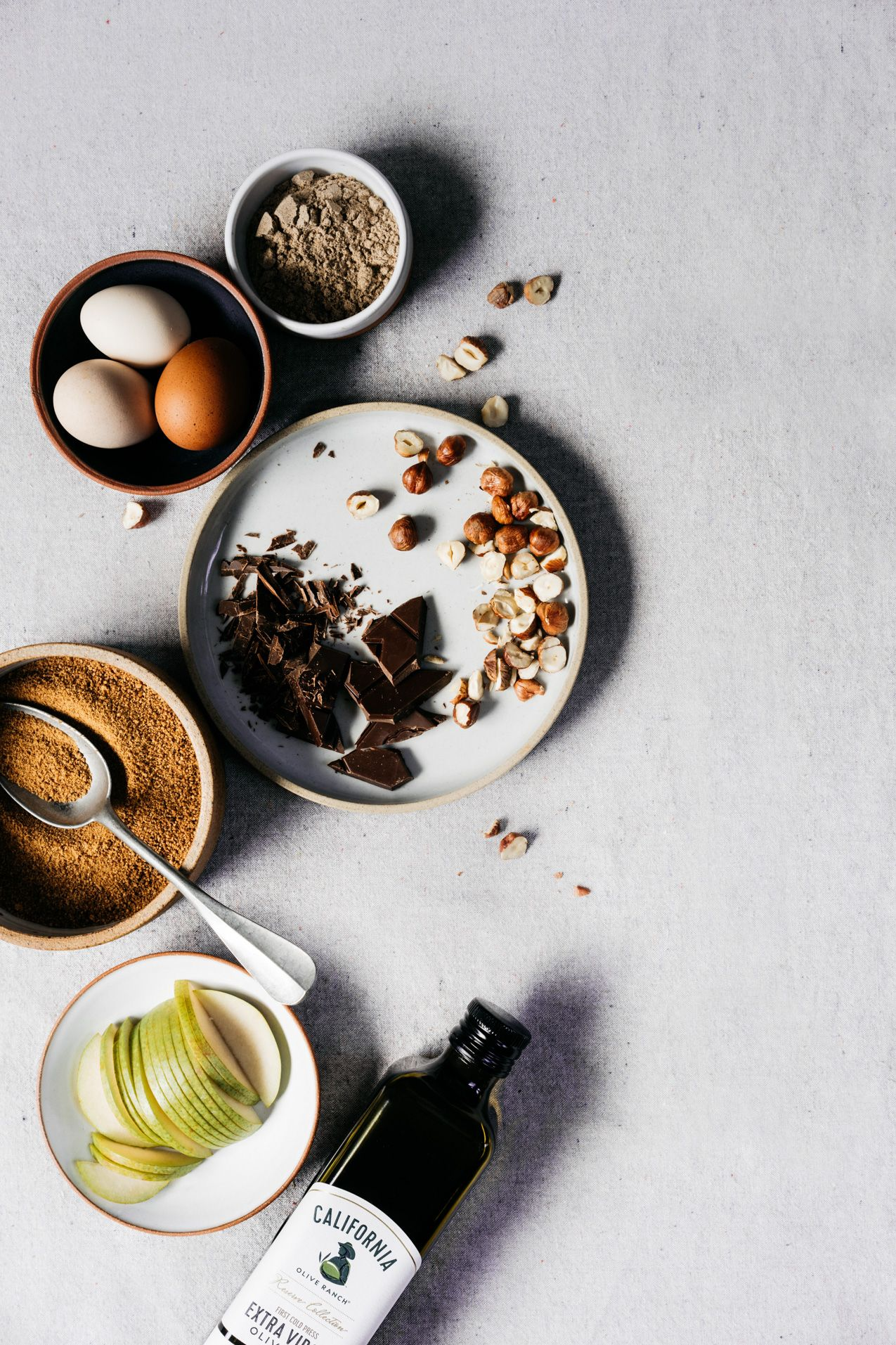 Chocolate Olive Oil Torte with Cardamom, Pears and Hazelnuts | TENDING the TABLE