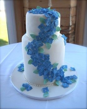 Simple floral wedding cake with hydrangeas. Lana's Dough Delights, specializing in custom cakes, cupcakes and cookies.