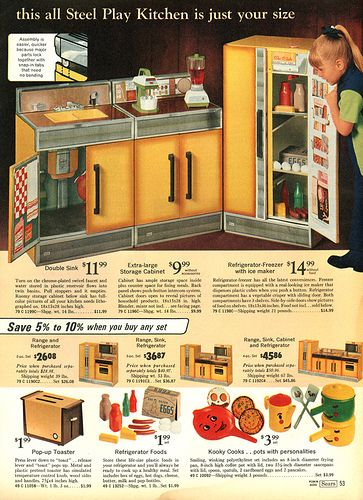 this is the way i remember play kitchens Steel kitchen set from the Sears catalog I HAD THIS ONE!!!!!!! :)