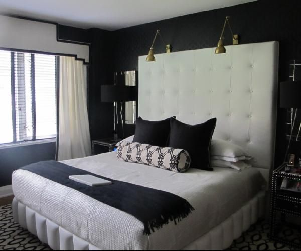Bedroom With Black Walls And Tall White Headboard With