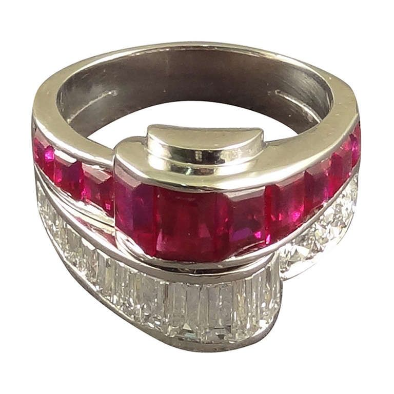 Oscar Heyman 1950s Baguette Ruby Diamond Cocktail Ring | From a unique collection of vintage fashion rings at http://www.1stdibs.com/jewelry/rings/fashion-rings/
