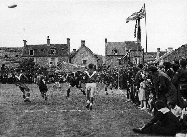 July 14th 1944 - In the little town of Coursoulles near the coast, British troops played a football match against the local French team