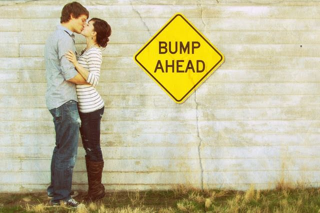 Cute baby announcement.  I think I'd pose the couple a little differently though.