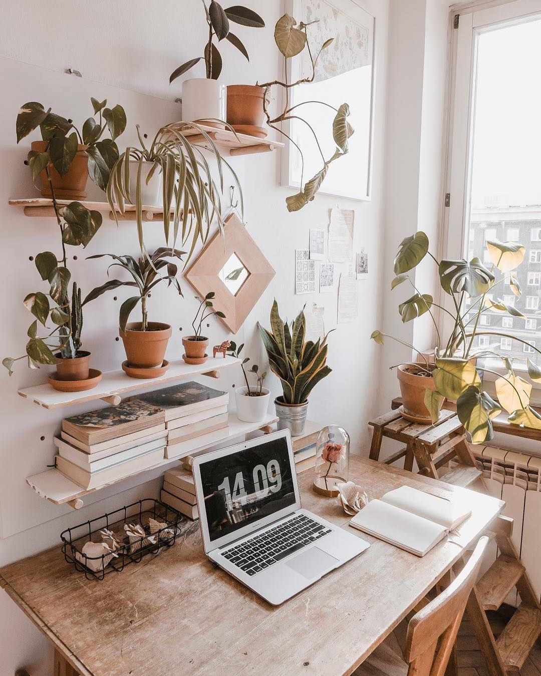 Home office in a cozy natural design full of plants.   Cozy home ...
