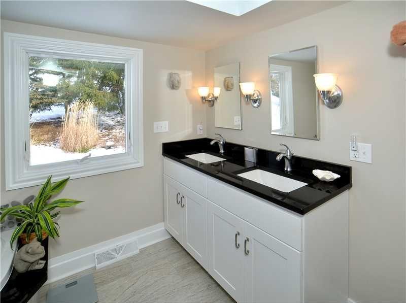 Contemporary Master Bathroom with Indian Premium Black ... on Bathroom Ideas With Black Granite Countertops  id=18375