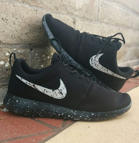 all white nike roshe with black tick with white spot