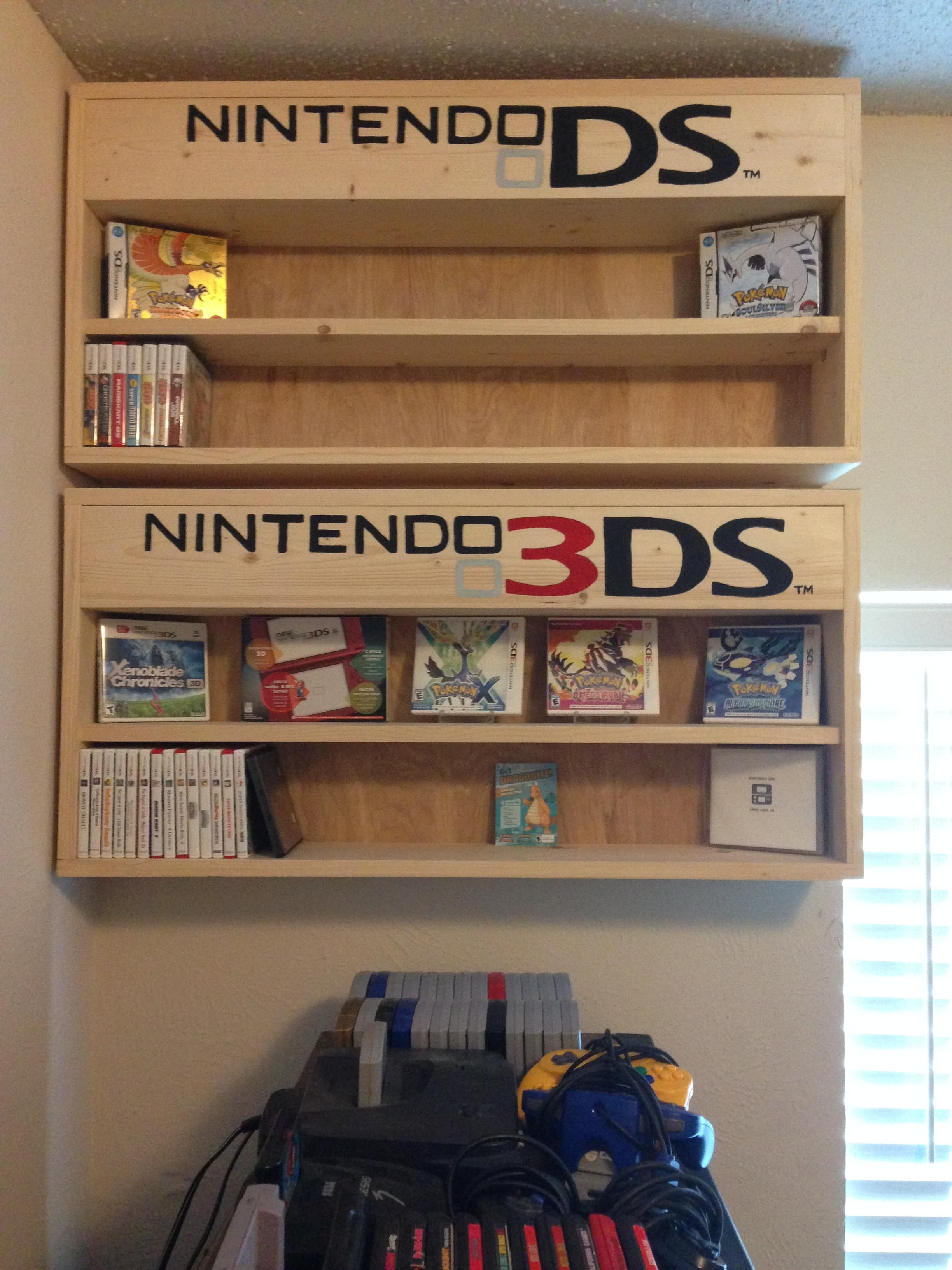 Built some shelves for my DS and 3DS games, also the logos flip up