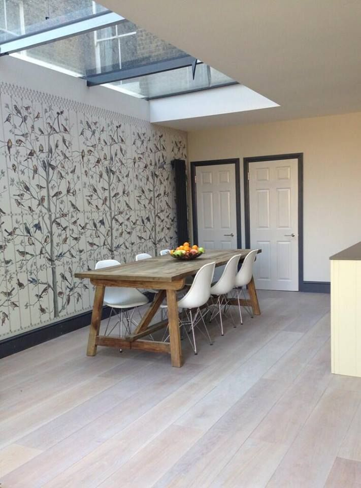 Fleur Ward Interiors has used COLE & SON's Fornasetti II Uccelli wallpaper panels in this dining room, pairing it with some great paint colours and furniture.