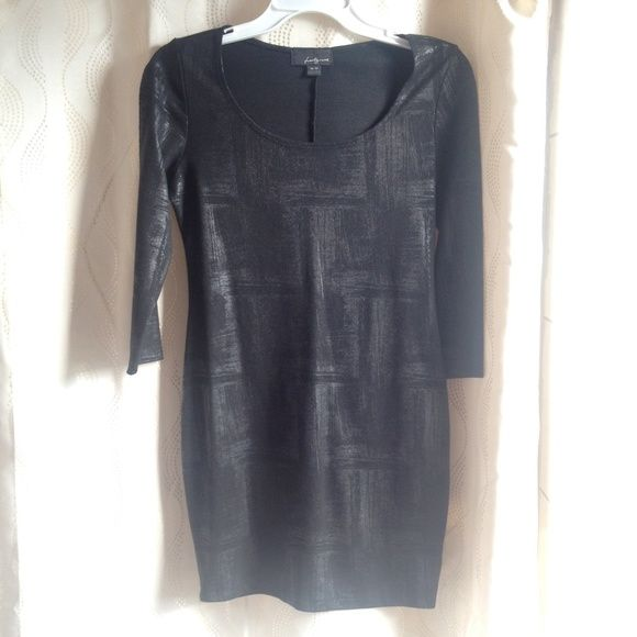 Black 3/4 sleeve dress Scoop neck with scratch line like patterns and a bit of sheen. Length is above the knees and has no zipper. Forever 21 Dresses