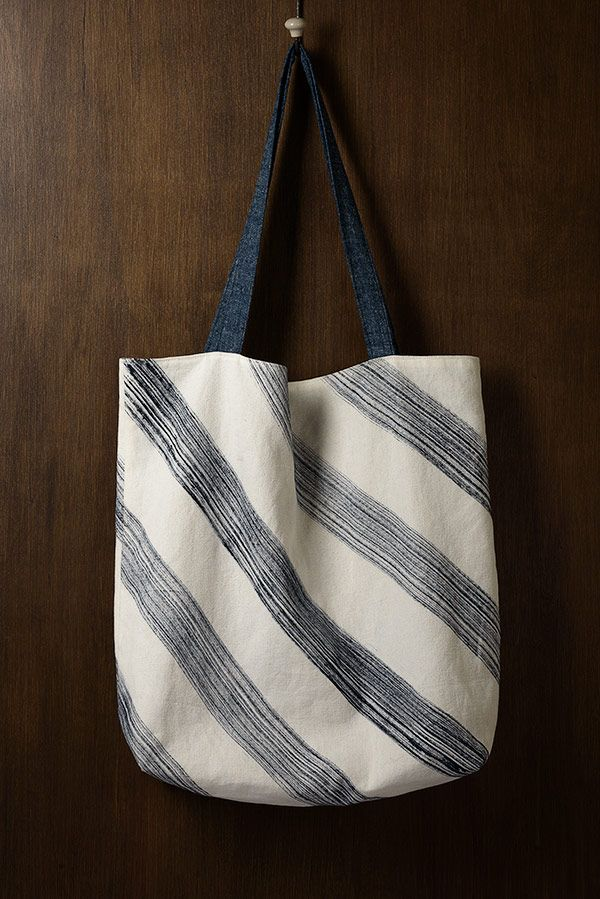 Handmade hemp/organic cotton canvas tote bag, with hand-painted midnight blue stripes by Windward Wearables