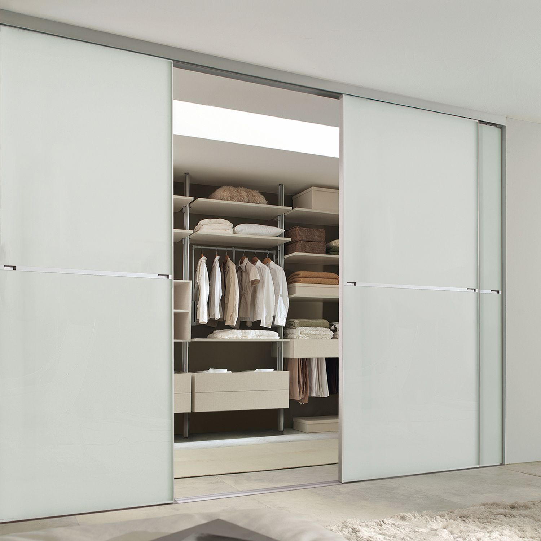 Minimalist sliding wardrobe doors are the ultimate in luxury design with beautiful aluminium frames & stunning glass panels