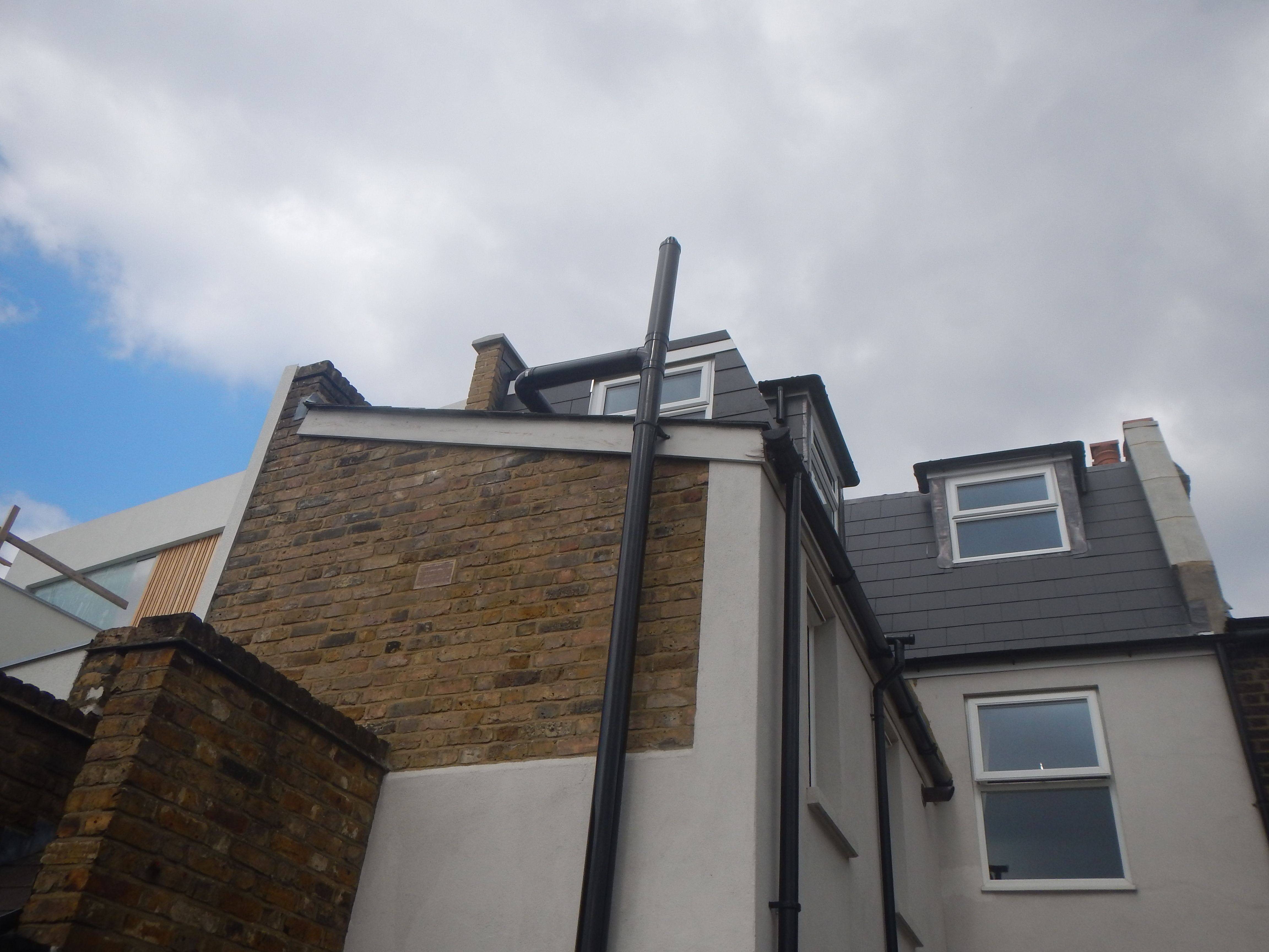 L Shaped Mansard Loft Conversion NW10.   Grey Composite Slate Tiles To  Dormer Face And
