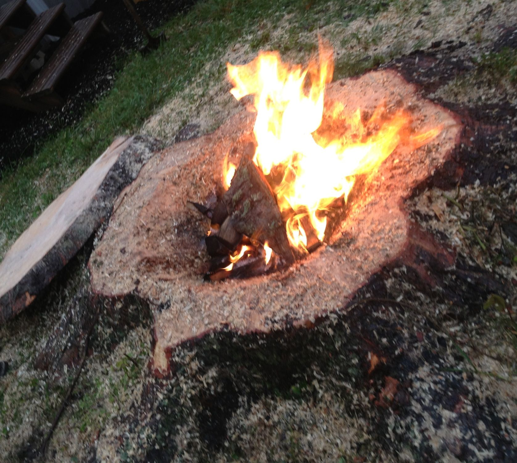 tree stump transformed into an awesome fire pit complete with lid to