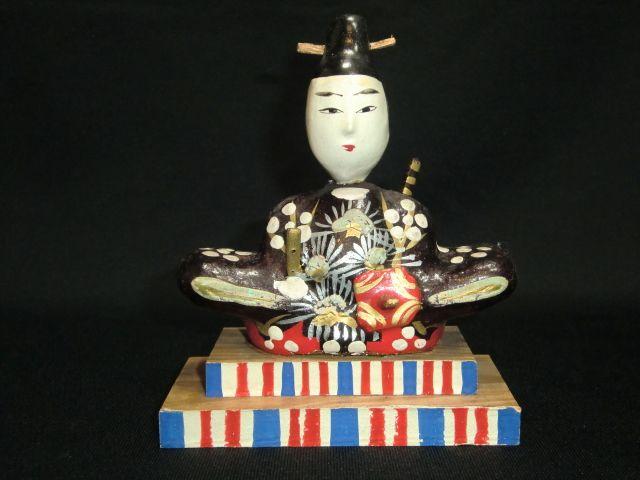 It is a Tenjin doll. It is Japanese God in hope of a staple grains abundant harvest.
