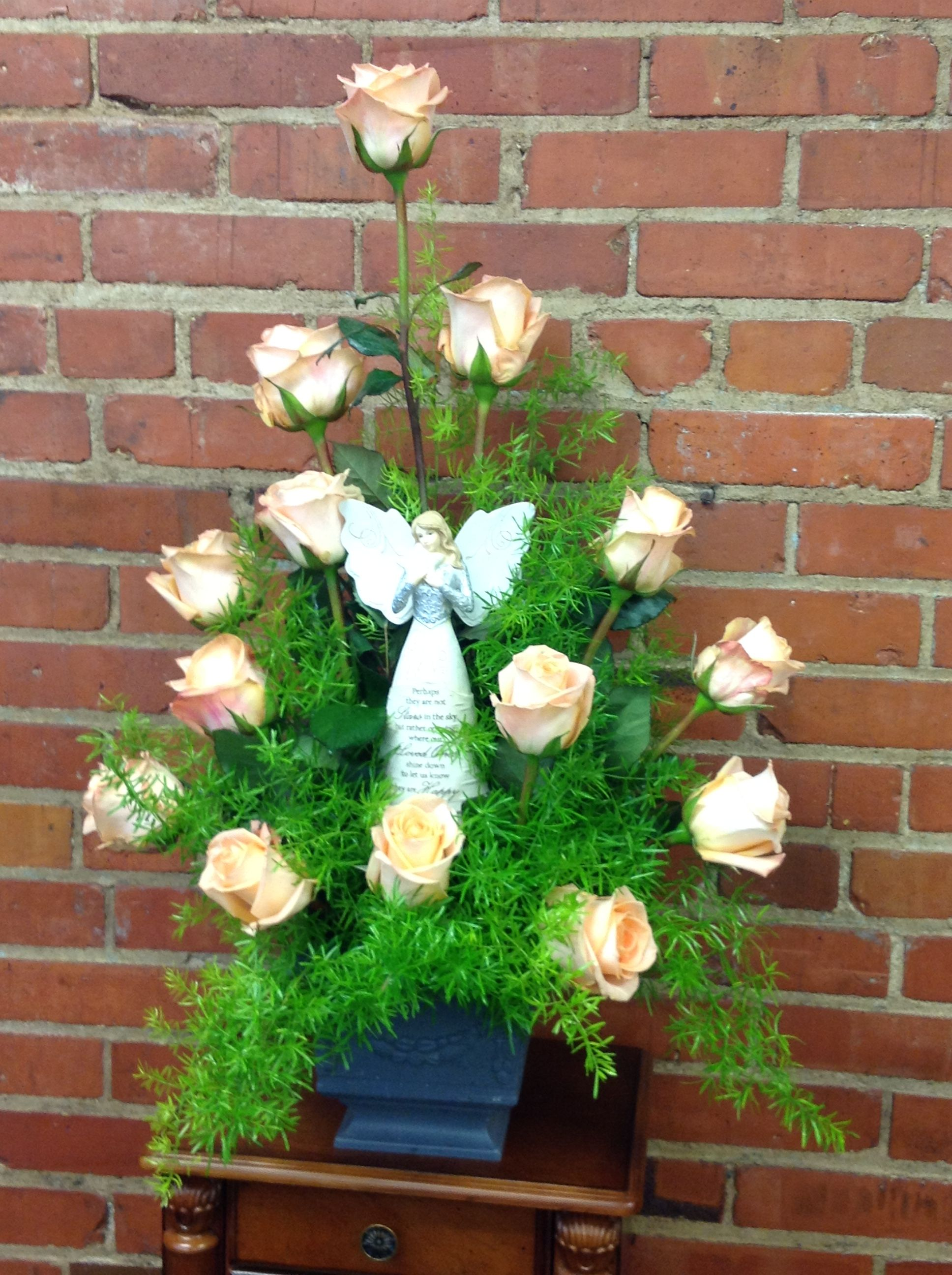 Beautiful peach roses surrounding and angel for a take