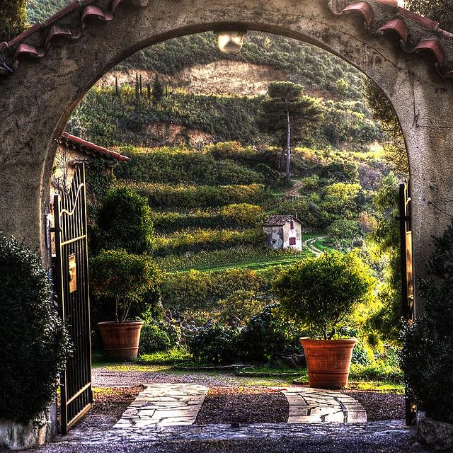 Entrance gate in Cassis, France, driveway stone in gravel