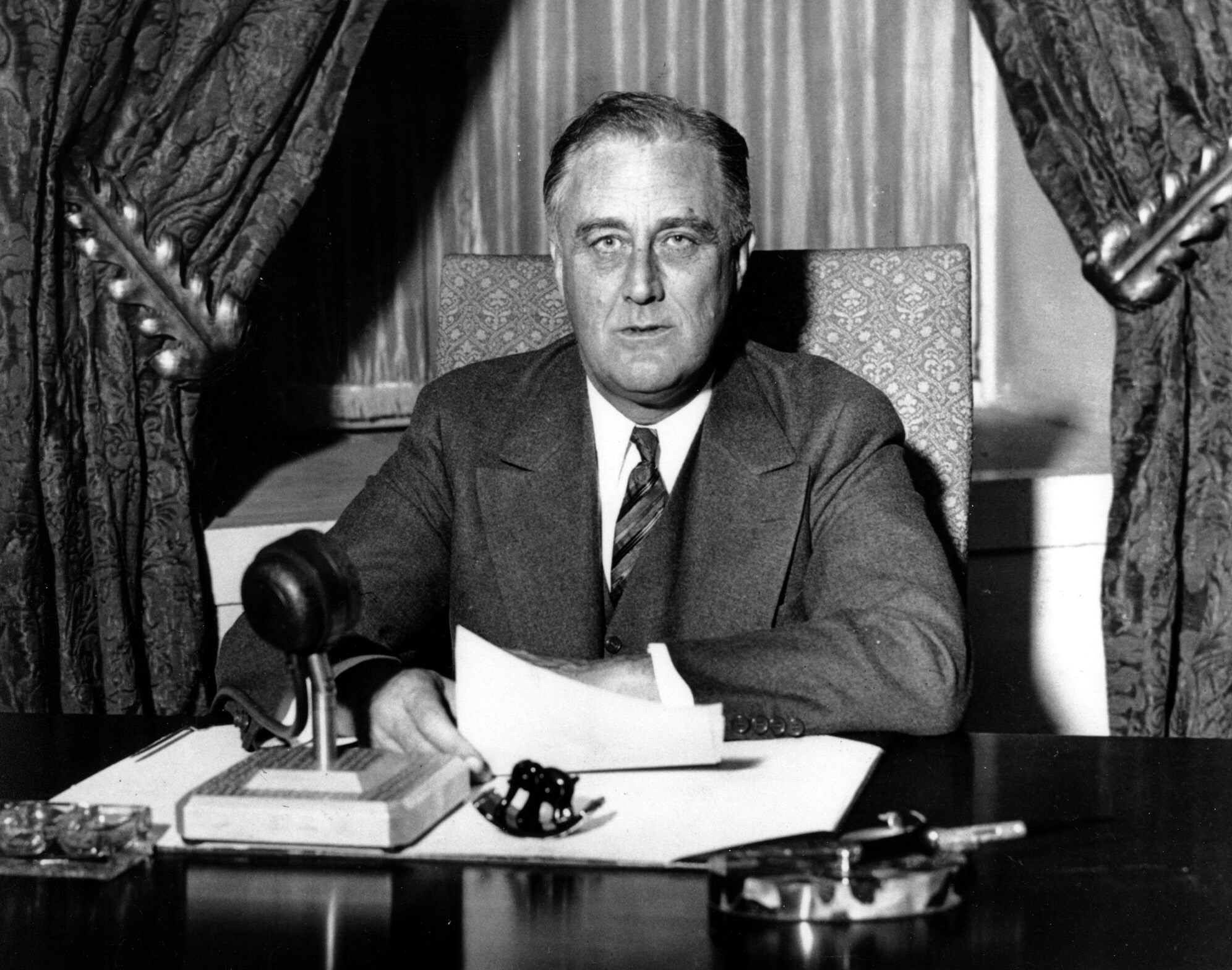 """President Franklin Roosevelt began making the informal radio addresses to the nation called """"Fireside Chats"""" on Sunday March during the Great Depression."""