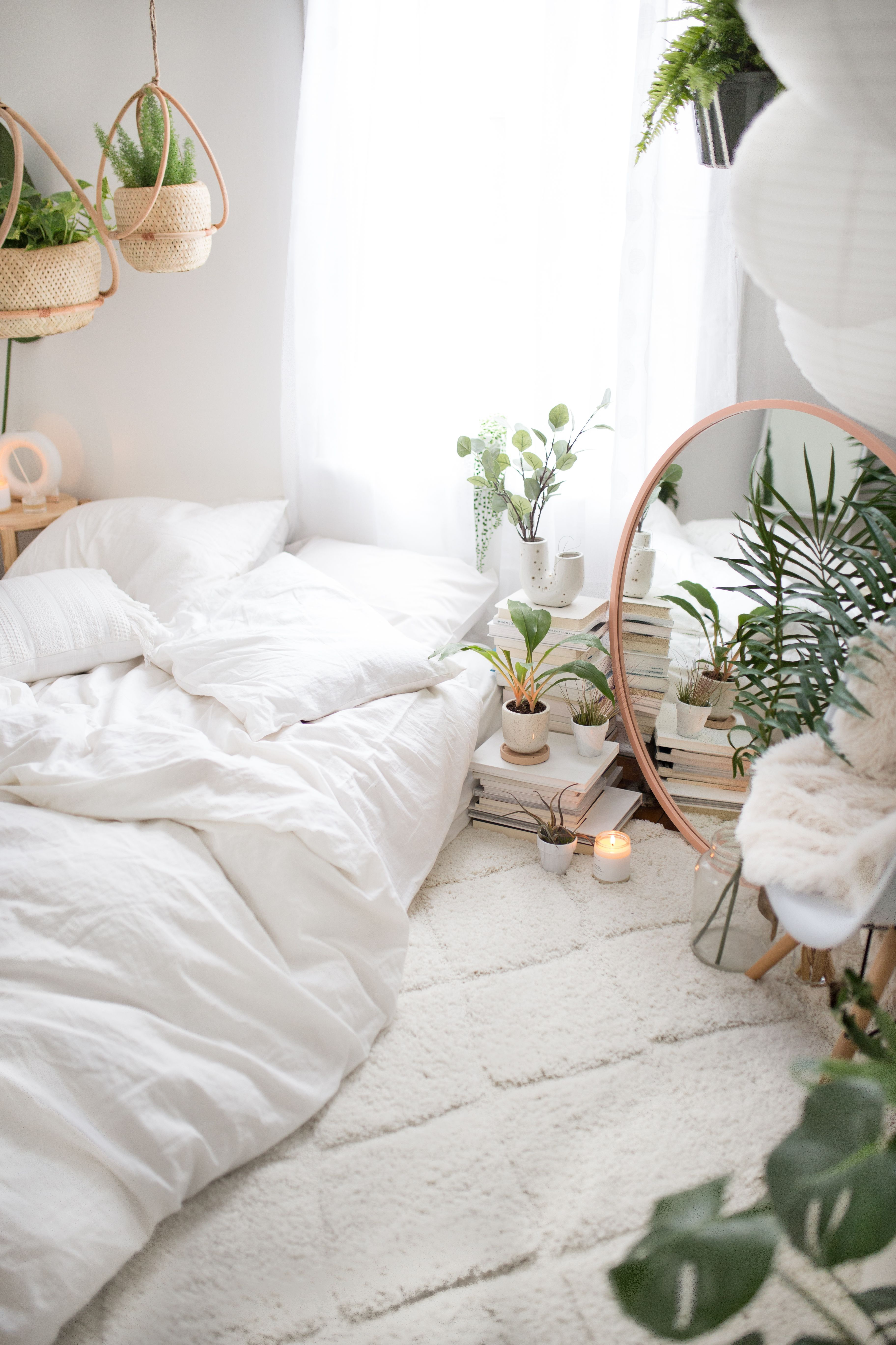 minimalist jungle white bohemian bedroom decor with mattress on the ...