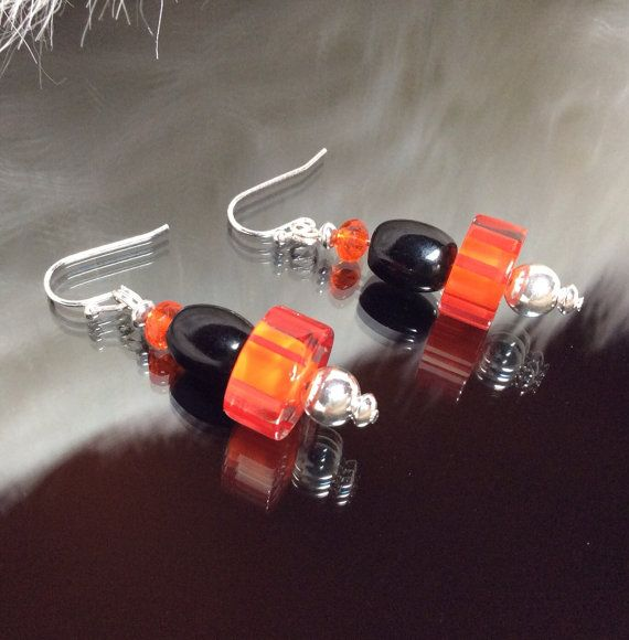 Beaded dangle earrings. Black oval round orange cane round silver beads and silver findings.  on Etsy, $17.00