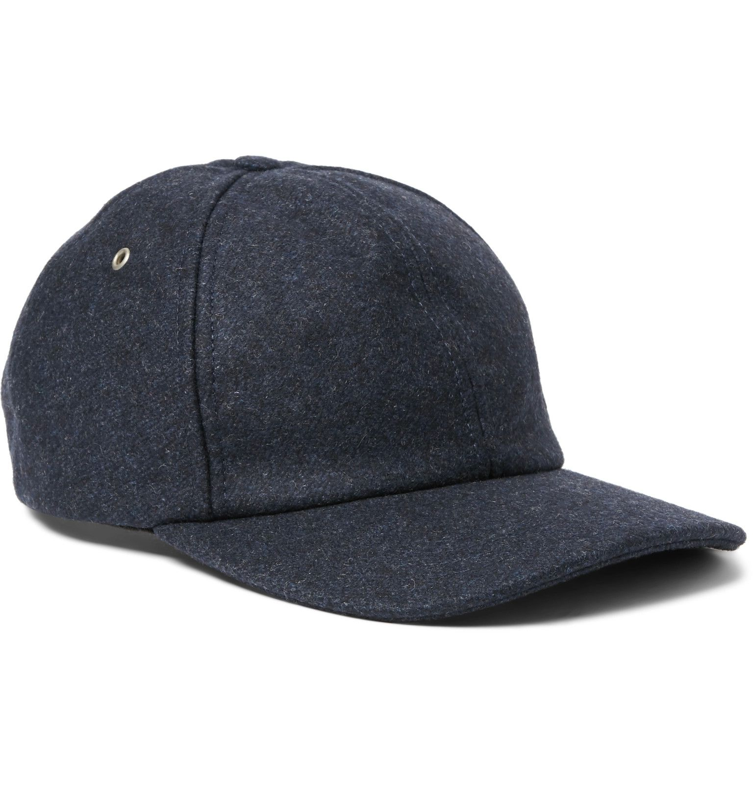 Made from an insulating wool-blend, <a href='http://www.mrporter.com/mens/Designers/AMI'>AMI</a>'s baseball cap proves the sporty accessory isn't just for sunny weather. The easy-to-wear navy hue makes it a timeless choice, while the adjustable back tab offers a customised fit.