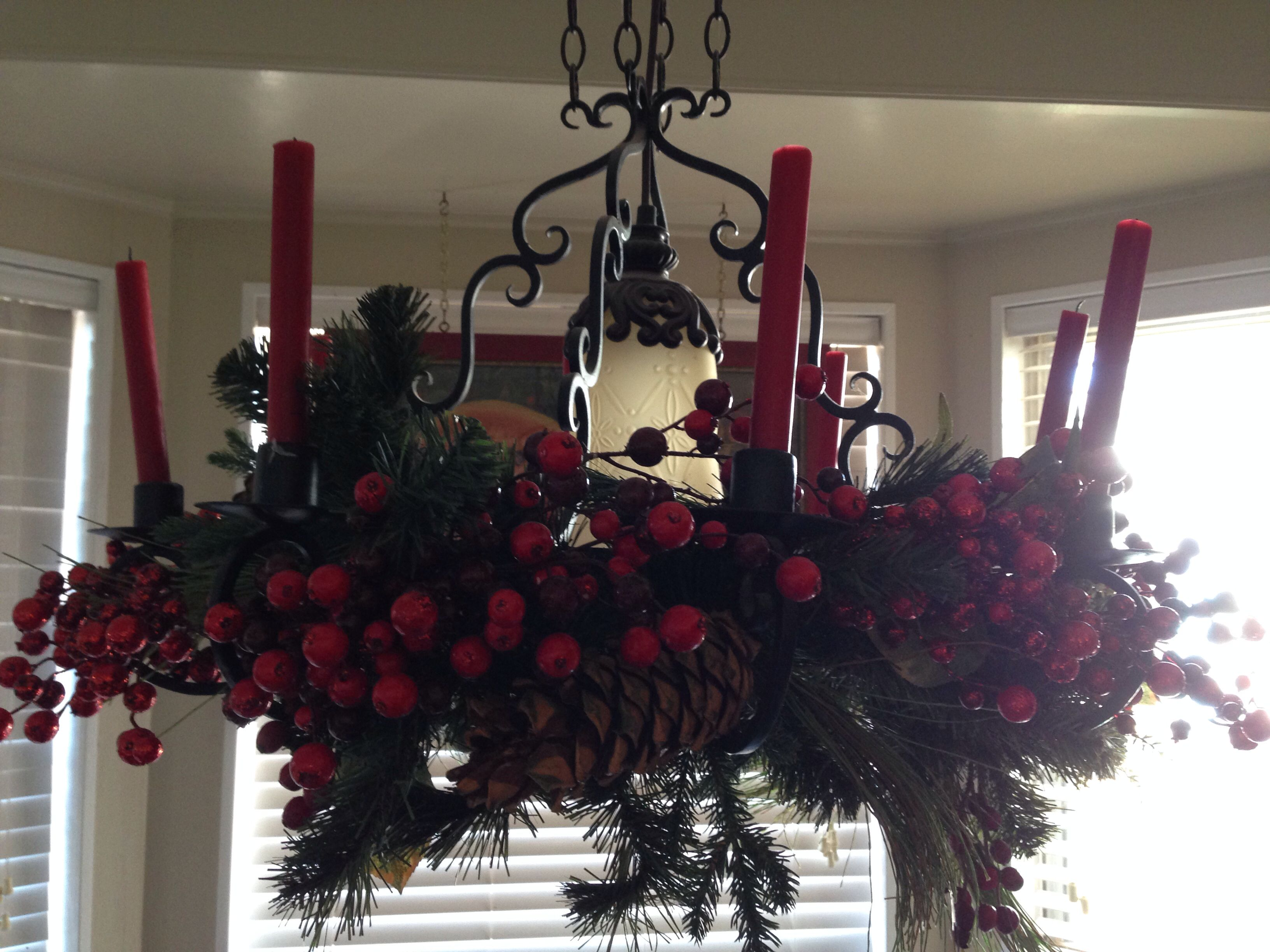 Kitchen chandelier with greenery and berries