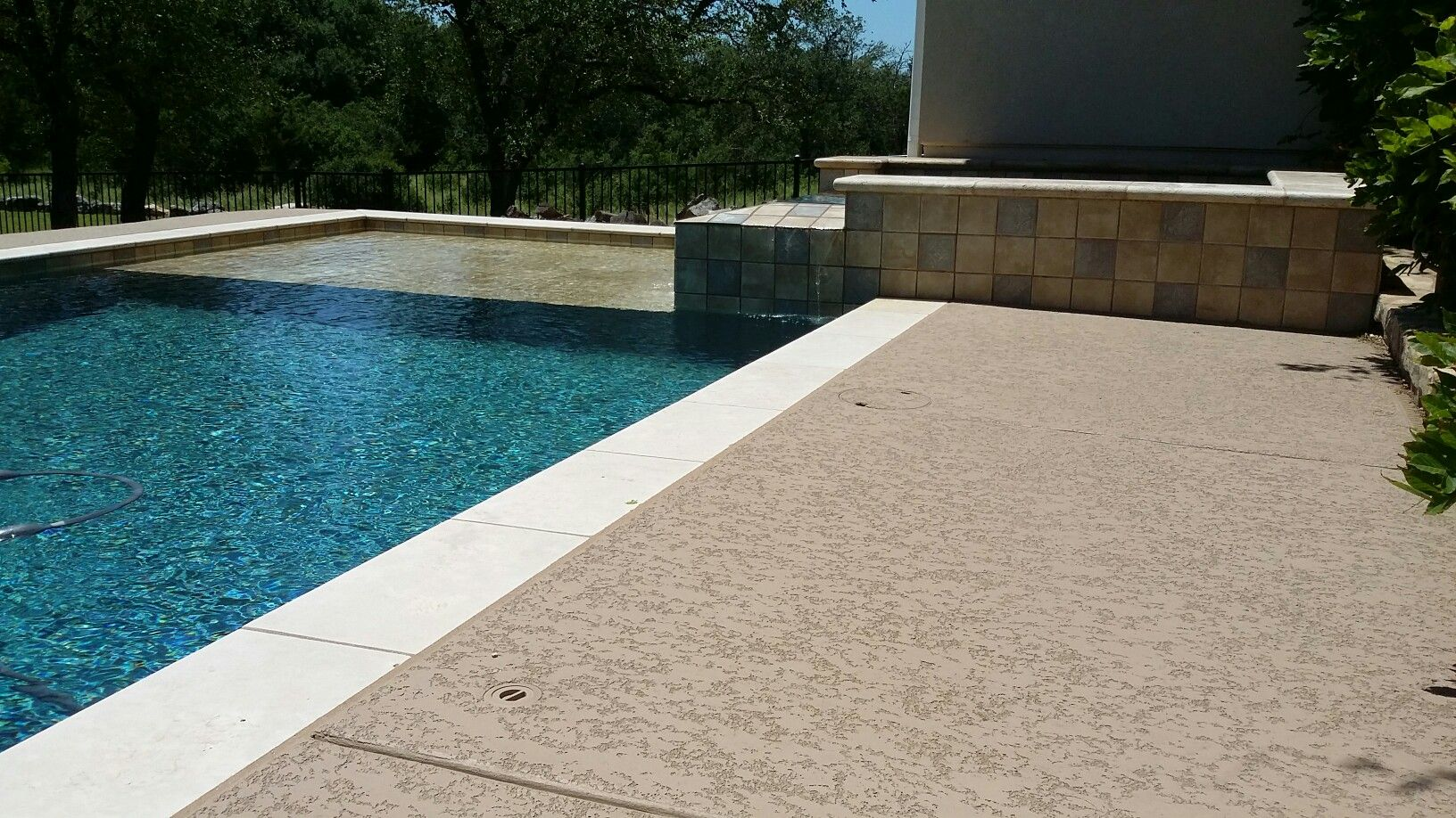Sundek Classic Texture With A Light Natural Stone Coping Pool Deck Surface House With Porch Decks And Porches Pool