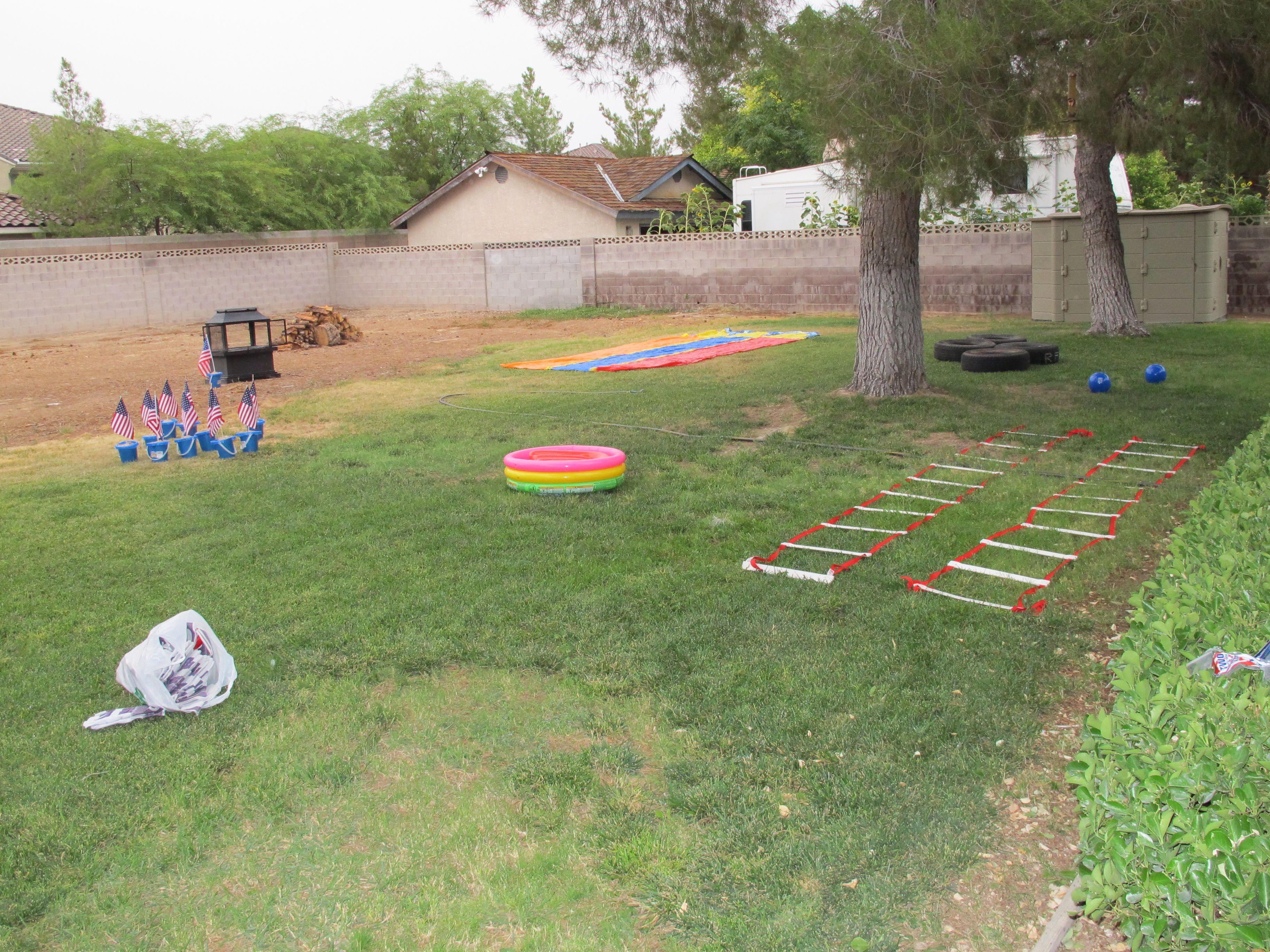 Relay race idea- ball between the legs, tires, agility ladder criss-cross, crab walk, hula hoop hop, sand bucket zig-zag, and slip n slide to finish it off!