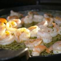 Shrimp Scampi is a recipe typically cooked up in a saute pan with a rich, buttery sauce. We take this classic dish to the grill to give the shrimp a light char before hitting the sauce where it will soak up the butter and white wine to make this truly fantastic. The secret is that the shrimp sweat out the water they have been sitting in so they can draw in the flavor.