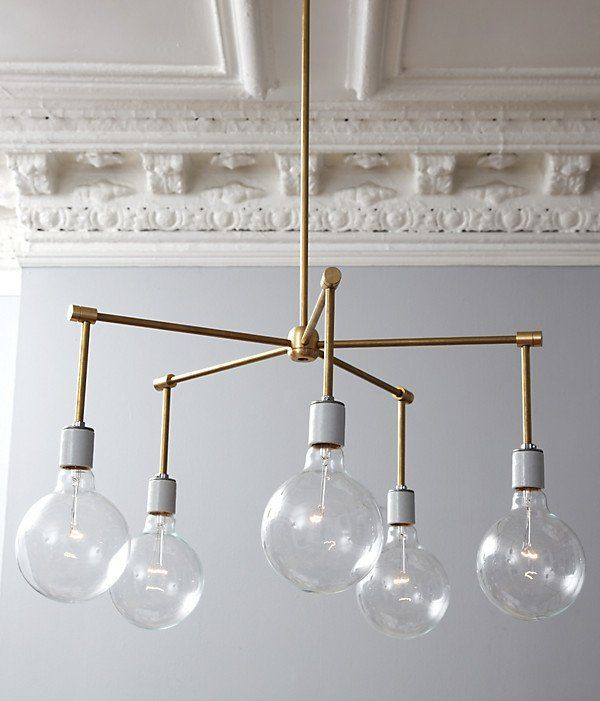 I'll bet you wish you could afford a sleek and stylish brass chandelier like this one. Well, guess what, lucky ducks?  Those crazy geniuses over at One Kings Lane DIYed this beauty, and they'll show you how to do the same.