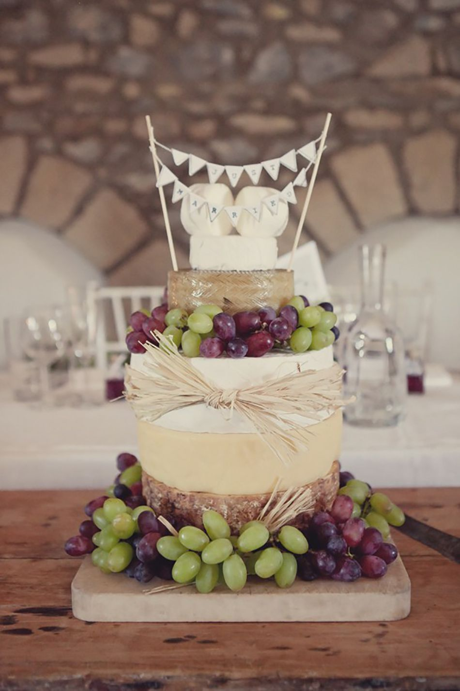 Cheese tower cake with bunting cake toper rustic wedding