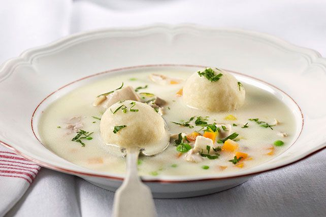 Try our matzo ball soup recipe! This chicken soup with matzo balls is made with rotisserie chicken. Our matzo ball soup recipe is perfect for cold days.