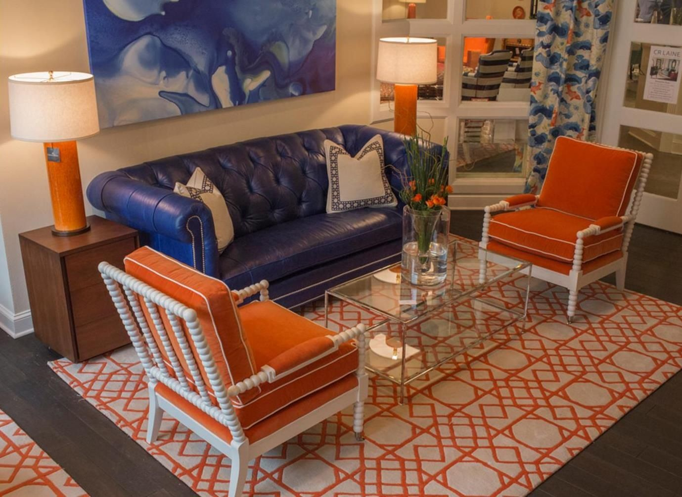 Orange and blue retro lounge area | Grey and orange living ...