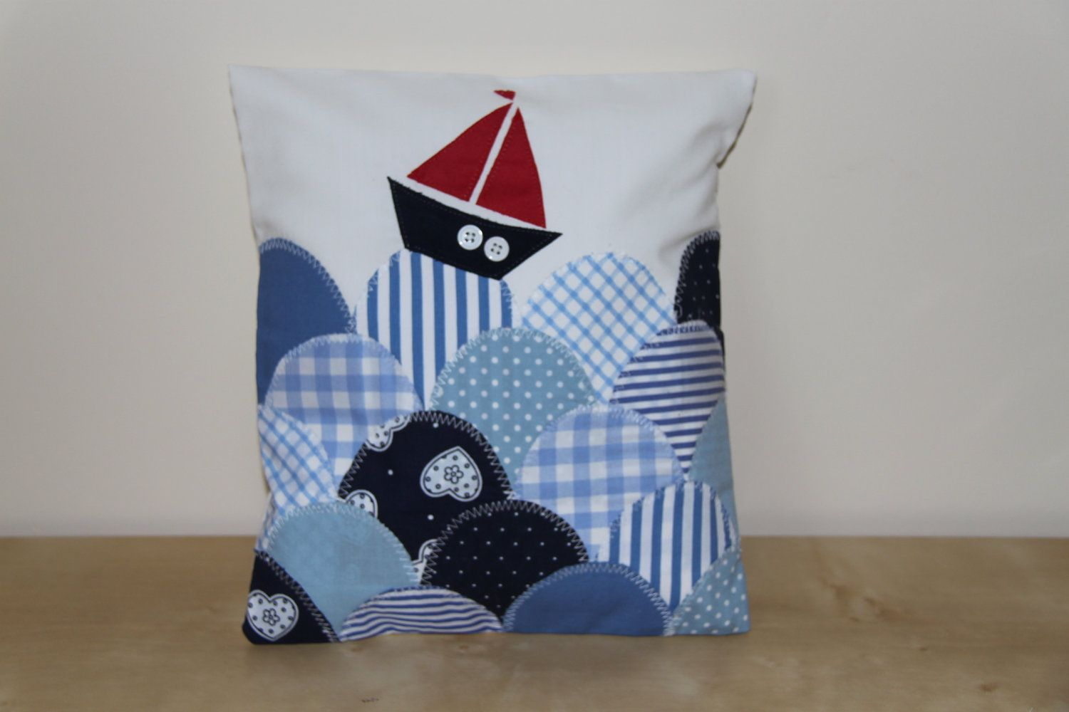 Handmade nautical cushion with boat and waves applique pillow