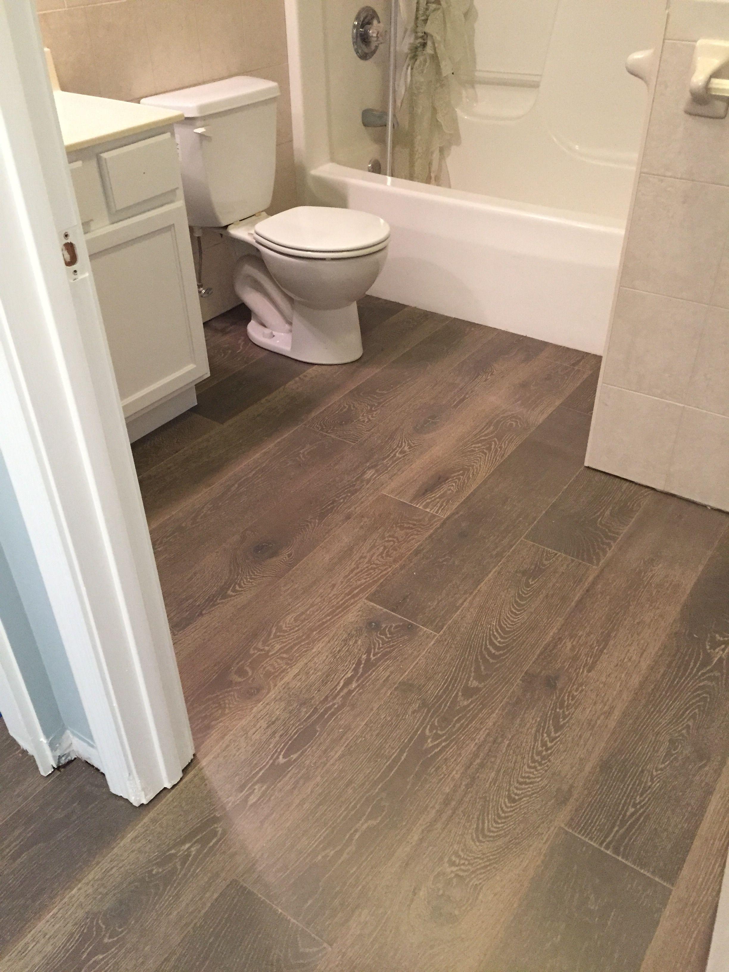 Engineered hardwood installed in a bathroom by Hampton