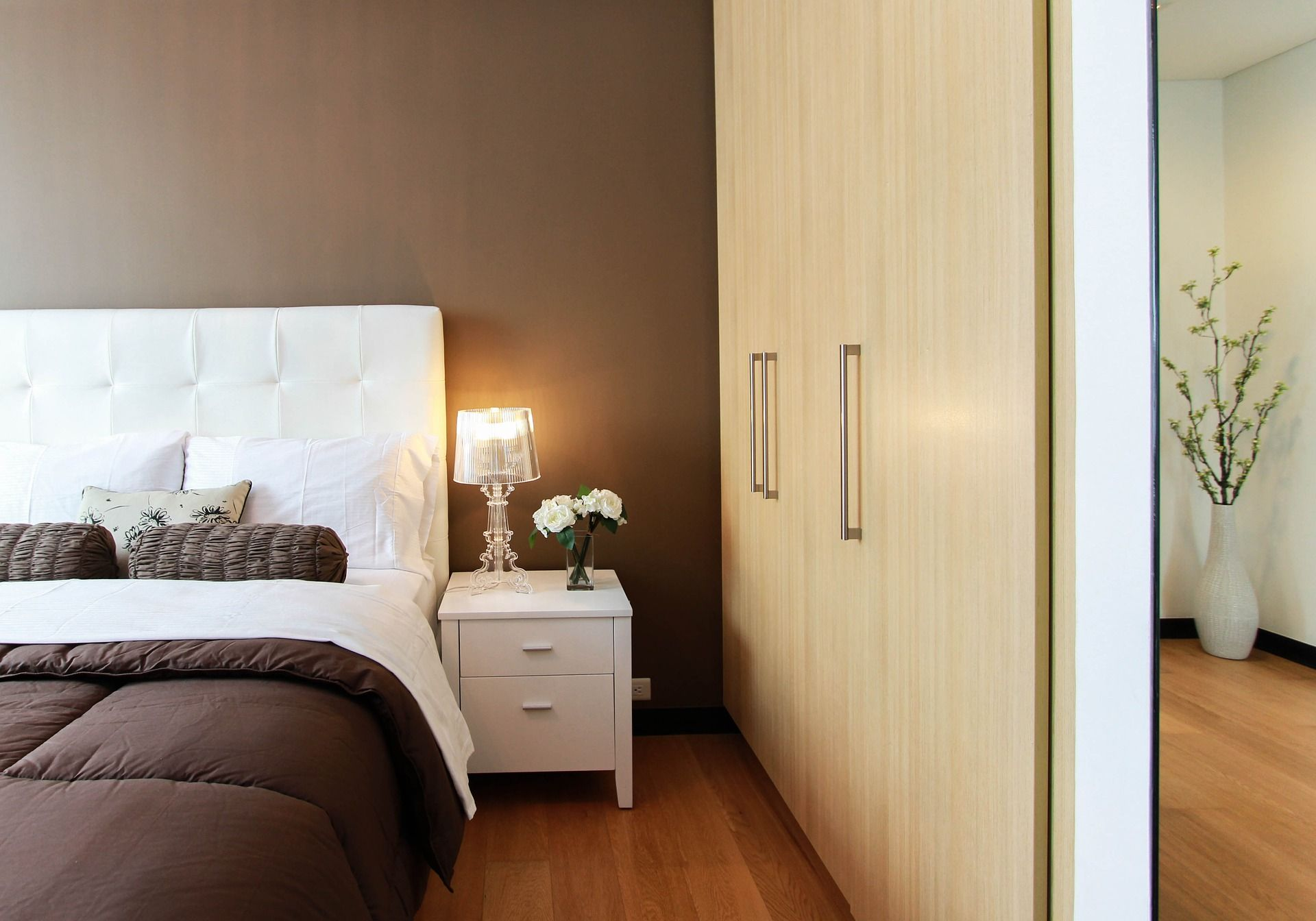 Bedroom with double bed side table and wardrobe