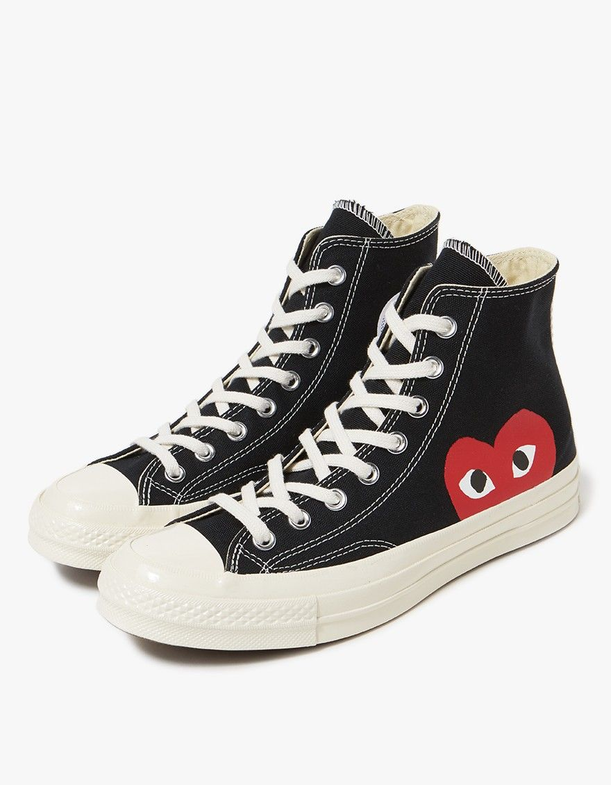 e0b9640486a25 Classic high top sneaker from Comme des Garçons Play in collaboration with  Converse in Black. Lace-up front with flat woven laces. Metal eyelets.