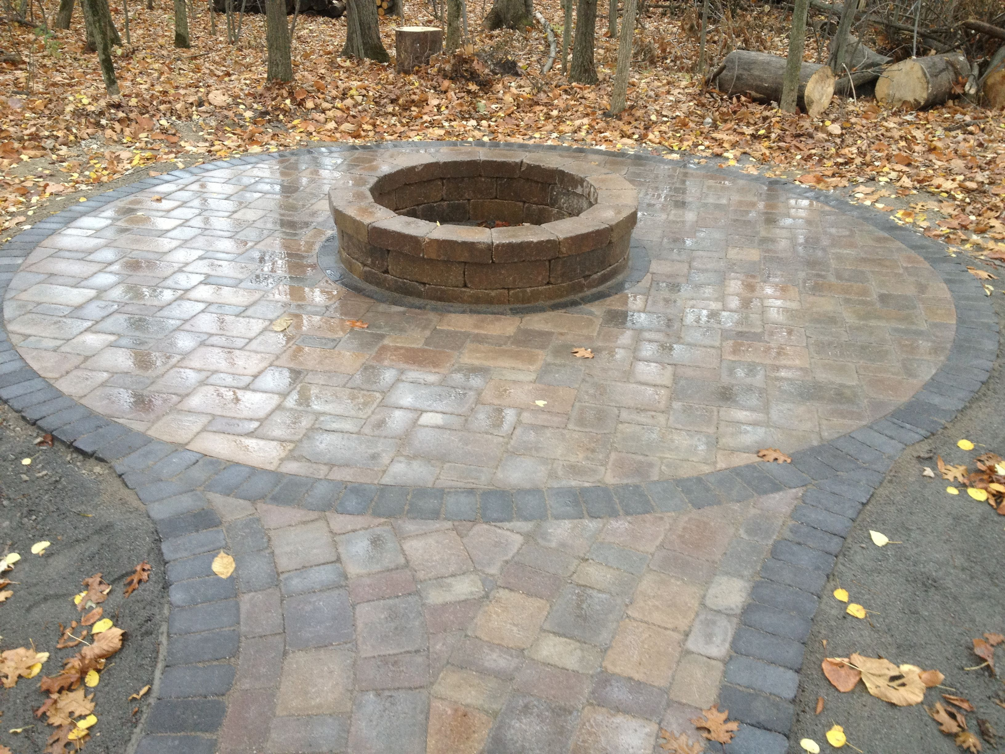 Fire Pit In The Woods Brick Paver Patio And Tumbled Paver Stone Fire Pit All Natural Landscapes Fire Pit Patio Fire Pit Landscaping Patio Stones