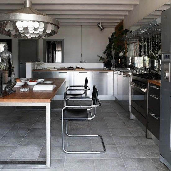 Silver Kitchen Worktops: Industrial Kitchen Stainless-steel Units Topped With Solid