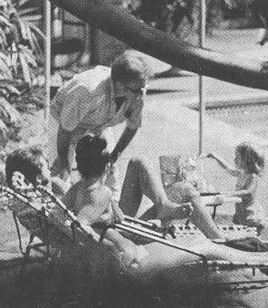 Elvis, Priscilla and Lisa at the pool.