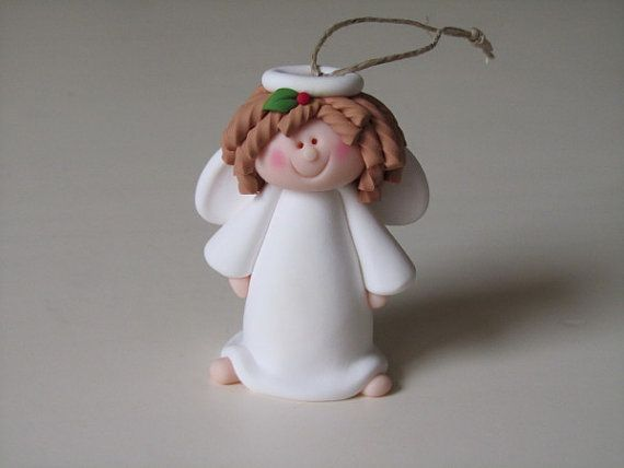 I handcraft my items from polymer clay. No molds or cutters are used.    This angel is 3 high.