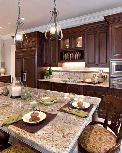 Kitchen Renovations Dark Cabinets: A Kitchen With A Large Island And A Plate Rack Over The Sink.