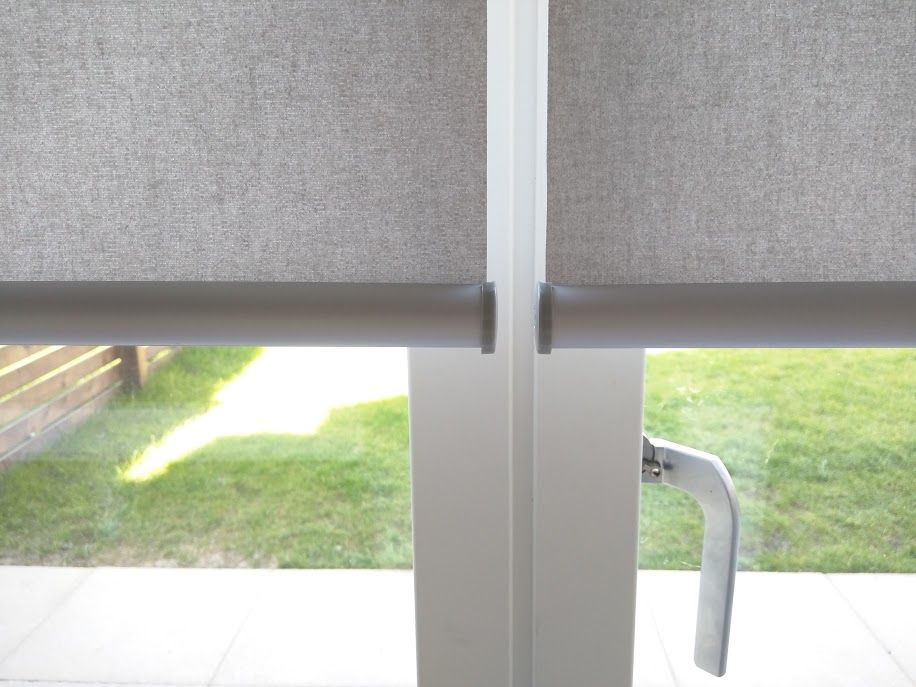 Close up showing minimal gap between 2 roller blinds when a central