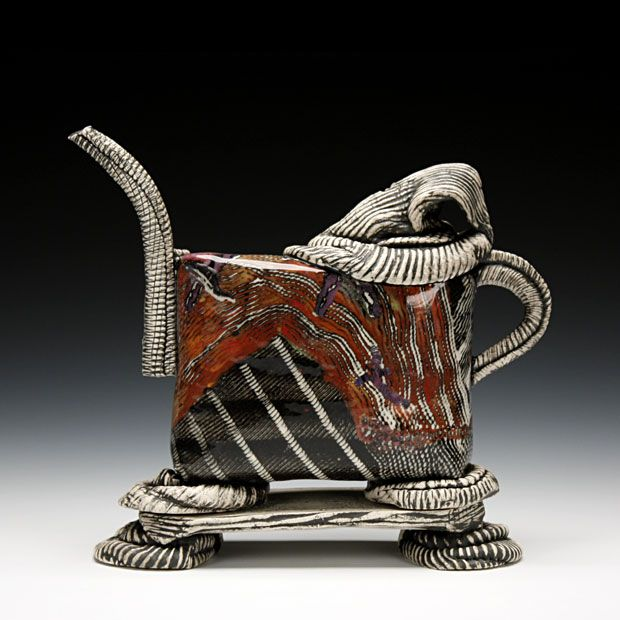 """""""hand built white stoneware with inlaid colored slips and glaze... it doesn't pour, but it will fill your teapot need"""""""