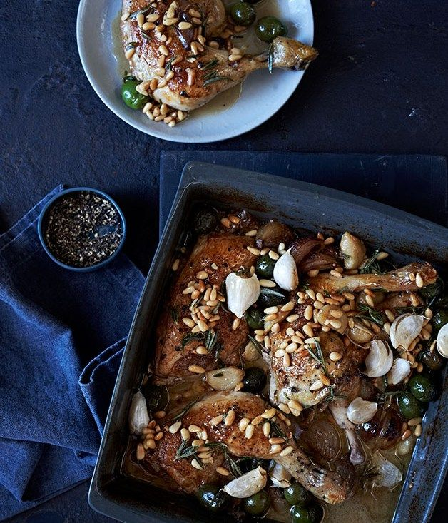 Chicken braised in vinegar with confit garlic, rosemary and pine nuts recipe - Gourmet Traveller