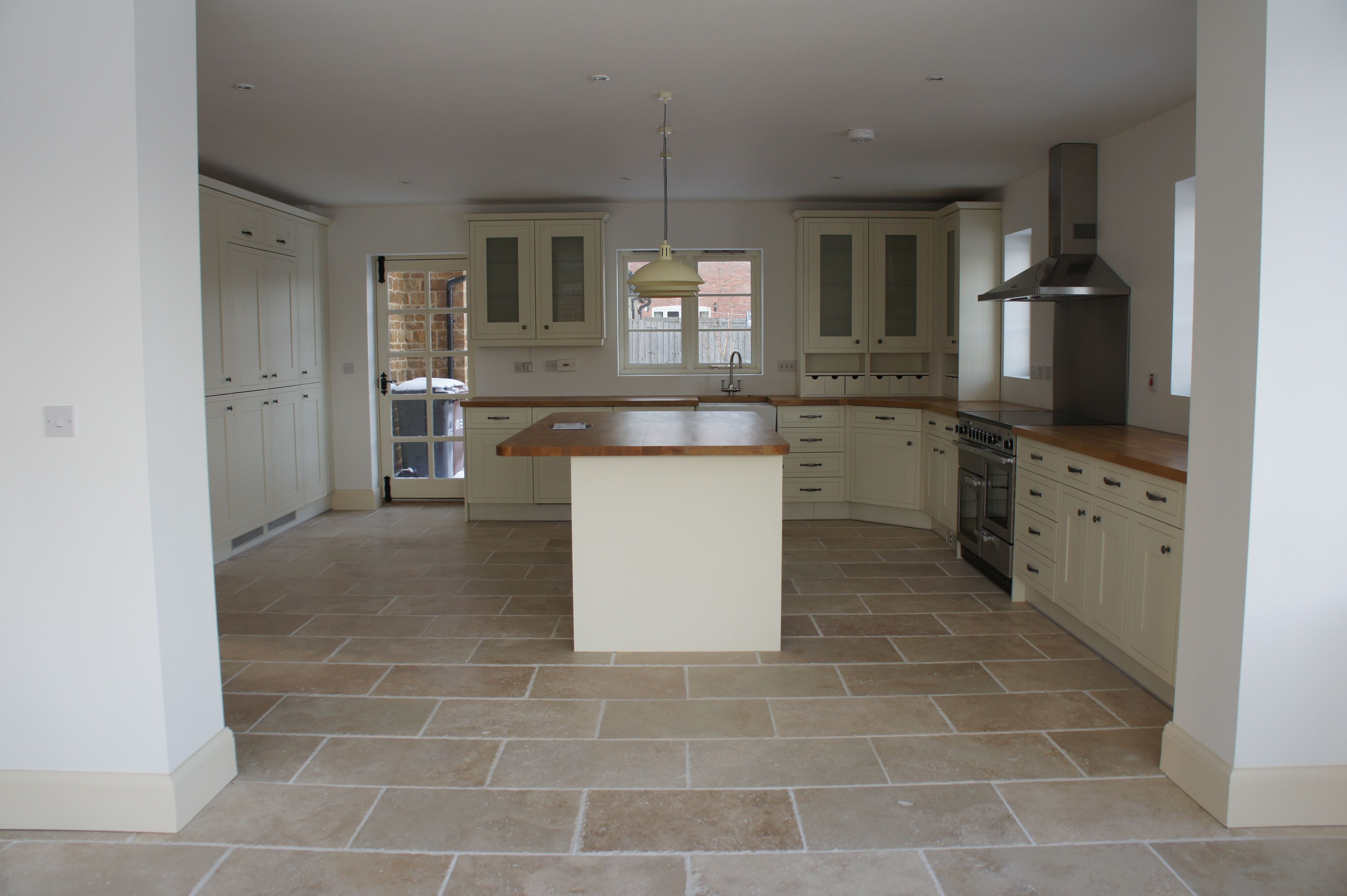 These Gorgeous Rustic Travertine Tiles Have Been Used In This Fab Kitchen To Create An Amazing Family Sp Kitchen Flooring Cleaning Marble Floors House Flooring