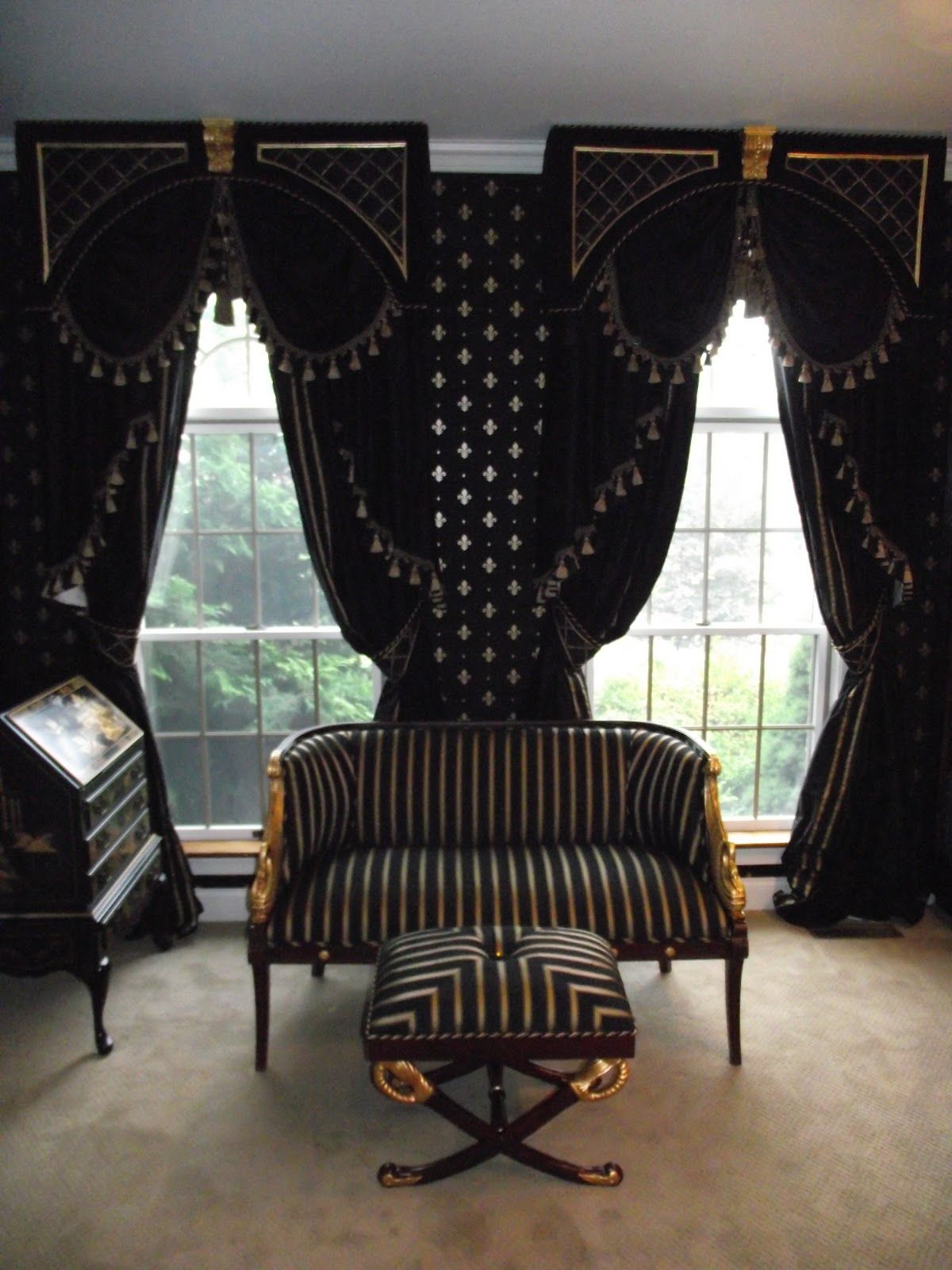 Drapes Neoclassic Settee And Ottoman In Black And Gold